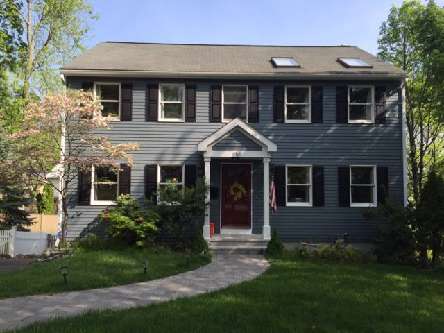 Pratt & Lambert exterior paint to match Hardie Board Evening Blue, Black Shutters, Red Anderson Storm Door, spring plantings