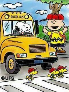 Snoopy Driving a School Bus With Charlie Brown as the Crossing Guard and Woodstock and Friends Crossing in Front of the Bus