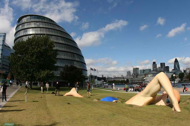 Unusual and Creative Statue and Sculpture Art.  London Ink's Man Swimming Statue, England