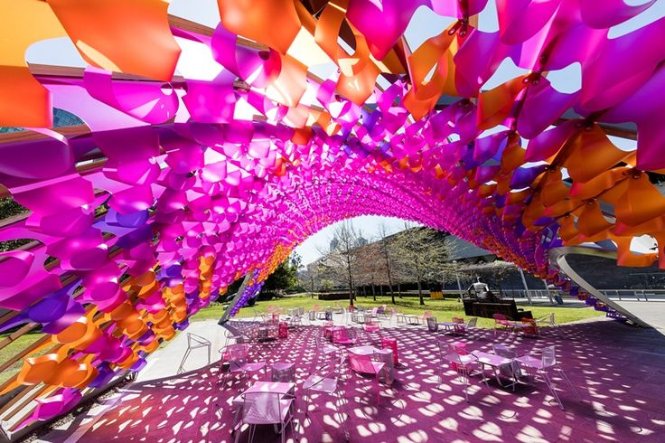 made of 1,350 hand-folded textile blooms, the pavilion pays homage to the iconic sidney myer music bowl in melbourne.
