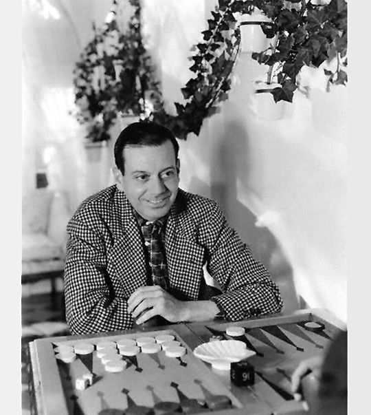"Cole Porter playing backgammon ""Night and Day"" in 1937.                                               Online backgammon > on.fb.me/1869cF3"
