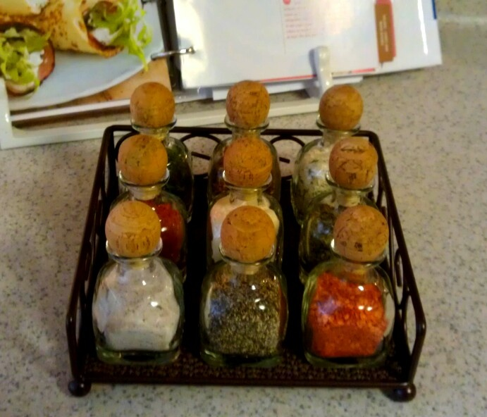 I used old Patron bottles and a napkin holder to make a really cool spice rack! I put  a little sticker on the bottom of each bottle with what's in it. We love it!