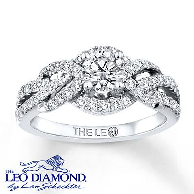 Lassos of extraordinary round diamonds flow around the magnificent round Leo Diamond center of this breathtaking engagement ring for her. The central diamond is independently certified and laser-inscribed with a unique Gemscribe® serial number. The ring is crafted of lustrous 14K white gold and has a total diamond weight of 1 carat. Diamond Total Carat Weight may range from .95 - 1.11 carats.