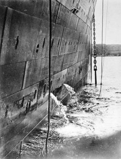 As Titanic weighs anchor, at Queenstown, Ireland - known today as Cobh - she is bound for New York.  In this photo - taken by Frank Browne - we can see her starboard panels.  It is the area of the ship which struck the iceberg a few days later.