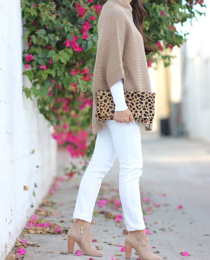 StylishPetite.com | Banana Republic camel sweater poncho, Clare V leopard foldover clutlch, AG white petite jeans, Nordstrom Rack abound ankle booties, Fall outfit, petite fashion, fall style, winter white, Fall/Winter cold weather outfits.  Click the photo above for full outfit details!