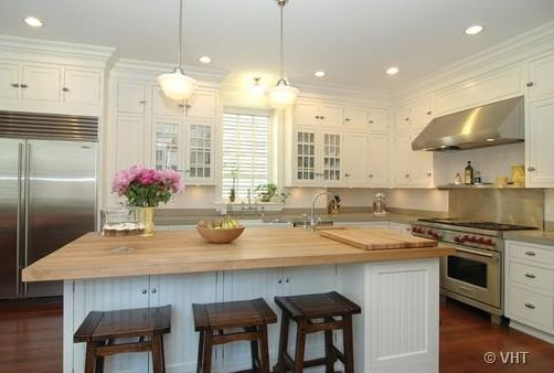 Kitchens walnut stools butcher block island countertop for White kitchen cabinets butcher block counter