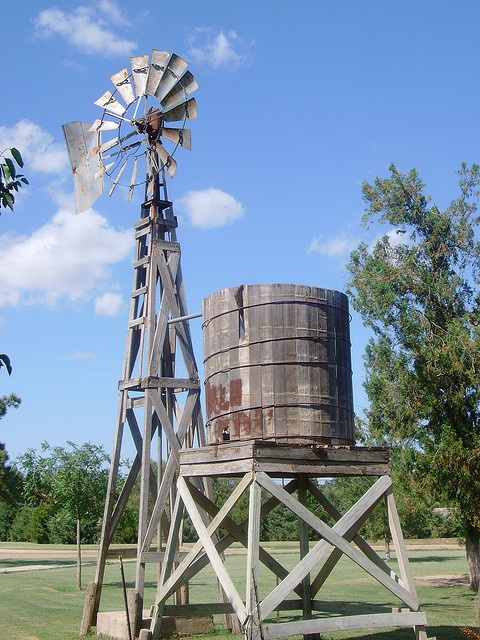 Memories...as a little girl I drank water out of an old metal cup from a water tank just like this one.