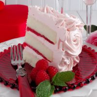 Pink Champagne Velvet Layer Cake by WickedGoodKitchen.com ~ Moist, tender white cake reminiscent of its buttermilk cake cousin, Red Velvet Cake, our Champagne Velvet Layer Cake is made with a champagne reduction and a hint of almond and vanilla. It is iced with Pink Champagne Buttercream and filled with Strawberry-Raspberry Filling for a truly romantic dessert experience. Perfect for Valentine's Day! | dessert recipe