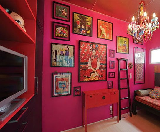 This magenta-colored wall is bold and bright and the ...