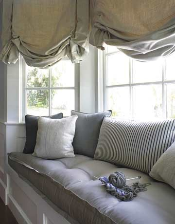 This said it is gray - I think it reads blue. Either way I love this window seat with the stripped fabric surrounded by white woodwork. I'm not a fan of the curtain. Designer Betsy Burnham:
