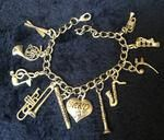 Band charm bracelet - 11 charms  Adorable bracelet with 11 charms representing a band. Cute bracelet for the performer, teacher or parent.  Drum sticks, french horn, music symbols, trombone, flute, clarinet, saxophone, base note, xylophone, trumpet   also available to add: Band Mom, marching band