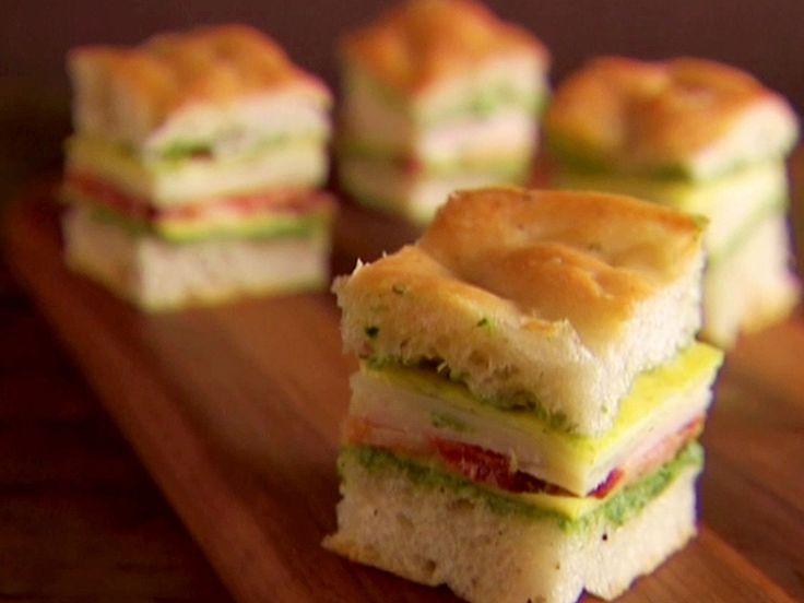 Mini Italian Club Sandwiches recipe from Giada De Laurentiis via Food Network: (Pesto, provolone, turkey, bacon sandwich. Giada also had a crepe on each sandwich, which I would omit.)