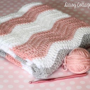 Instructions for crocheted ripple baby blanket. This pattern produces beautiful baby blankets and uses primarily double crochet stitches.