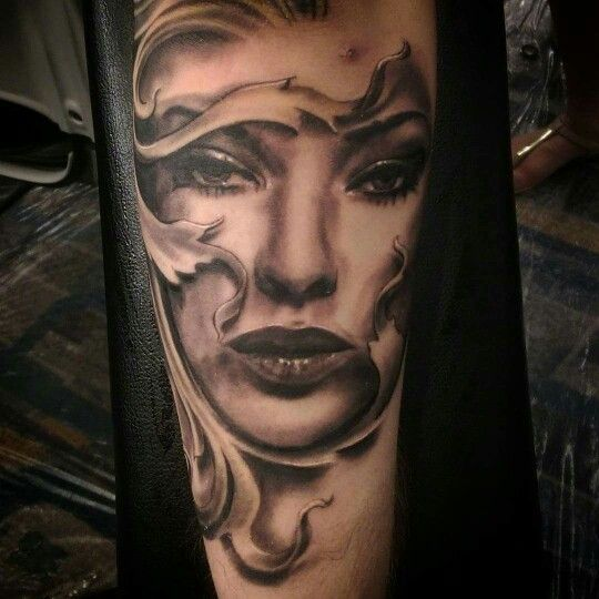 Tattoo. Woman's face and filigree