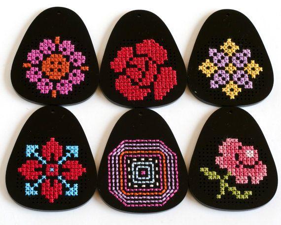 Modern Cross Stitch Necklace, Black Acrylic with Purple and Yellow Folk Art Design. $45.00, via Etsy.