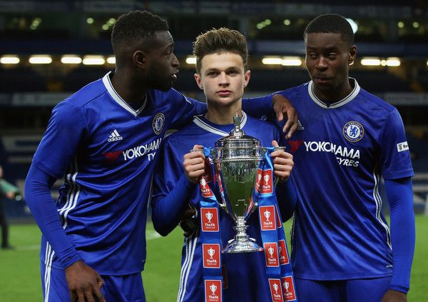 Chelsea players celebrate with the trophy following victory in the FA Youth Cup Final, second leg between Chelsea and Mancherster City at Stamford Bridge on April 26, 2017 in London, England.