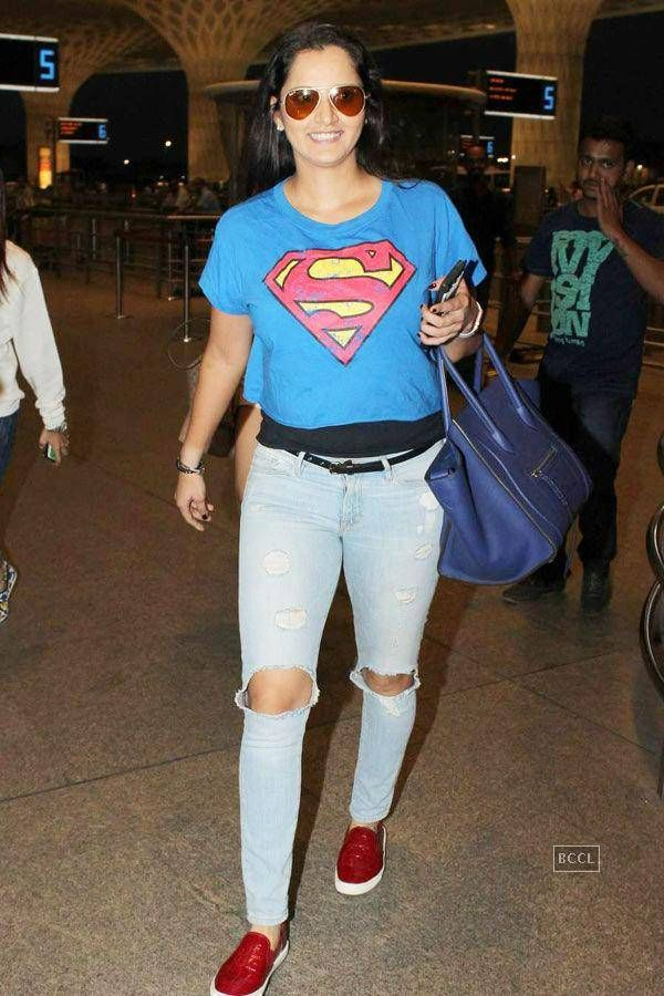 Sania Mirza looks horrible exposing her knees in jeans.Having so much money.This only exposes her character.