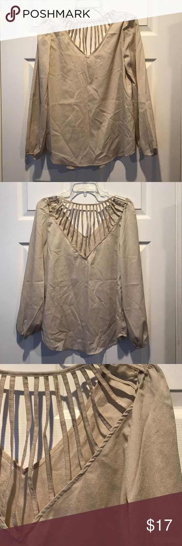 Strappy Back Beige Blouse Worn once, excellent condition. Bought from boutique. Fits M/L Tops Blouses