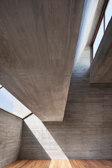 Seashore Library   Vector Architects   Curved concrete ceiling and multi-level openings creates beautiful beams of light