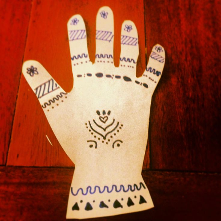 Design your on henna art without the mess. Cut out the outline of your child's hand using paper or cardboard. Then decorate in your own unique way. For inspiration 'google' henna hand art.