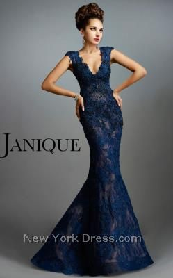 Make it a night to remember with this evening gown from Janique W977. This dress has cap sleeves and a modest V-neckline. Rich lace overlay works through the
