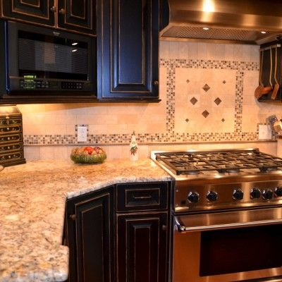 Silver gold granite countertops with black cabinets for Travertine accent tile