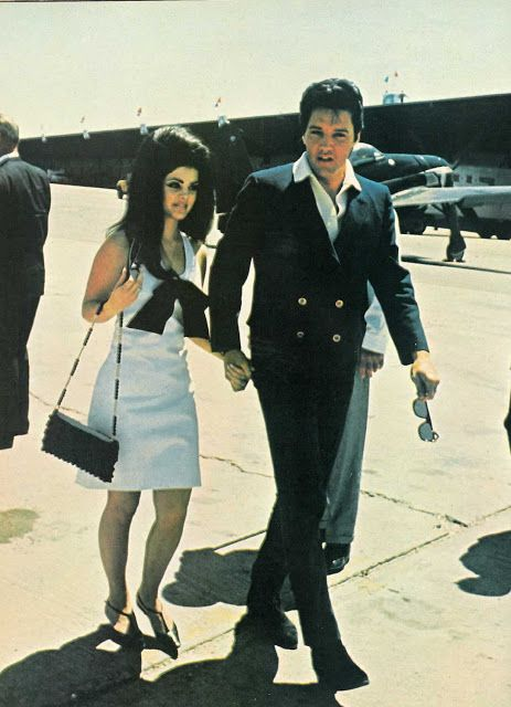Elvis and Priscilla on their way to board the jet to Palm Springs for their honeymoon.