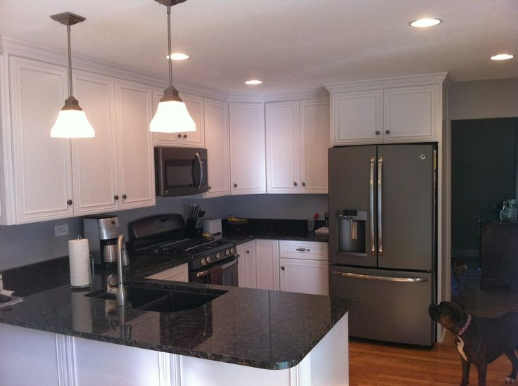 Slate appliances with white cabinets and dark countertops ~ I like!!!