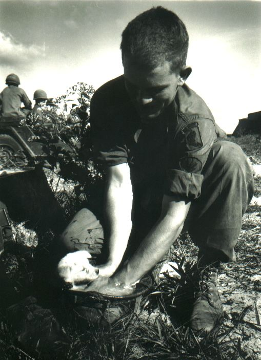 danthemedicman:  vietnamwarera:A soldier of the 173d Airborne Brigade washes a puppy found in a VC tunnel.I can't wait to be a Sky Soldier