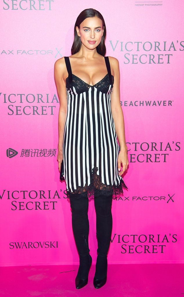 Irina Shayk from Victoria's Secret Fashion Show 2016 Pink Carpet Arrivals  A star and her stripes! The pregnant Russian beauty hit the pink carpet in a black striped mini accented with lace.