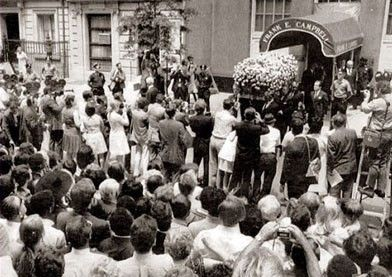 The casket of Judy Garland, a favorite of gay men, is carried from the funeral home, on June 27, 1969. The Stonewall Riots occurred later that night (early in the morning of June 28, 1969).