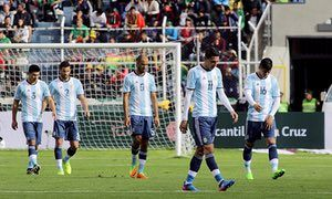 Argentina players show their disappointment during their defeat by Bolivia in a World Cup qualifier in La Paz.