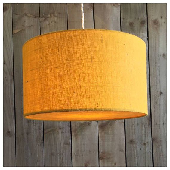 This stylish hessian lightshade & coordinating diffuser is handmade in our Bristol workshop from hessian fabric in yellow ▪️Need a swatch of this fabric? Please order from this listing- https://www.etsy.com/uk/listing/514198455/sample-of-fabric ▪️Fabric - yellow Hessian ▪️Made to order within 5 working days ▪️ Measures - Various Sizes ▪️Diffuser included. Diffusers are perfect for when shades are hung from high ceilings, they draw the eye to the shade desig...