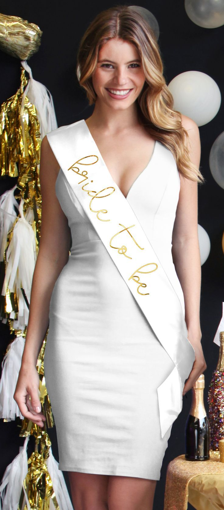 This all white look with a luxe white satin Bridal sash with a metallic gold Bride to be graphic is absolutely stunning!  Available exclusively at The House of Bachelorette.