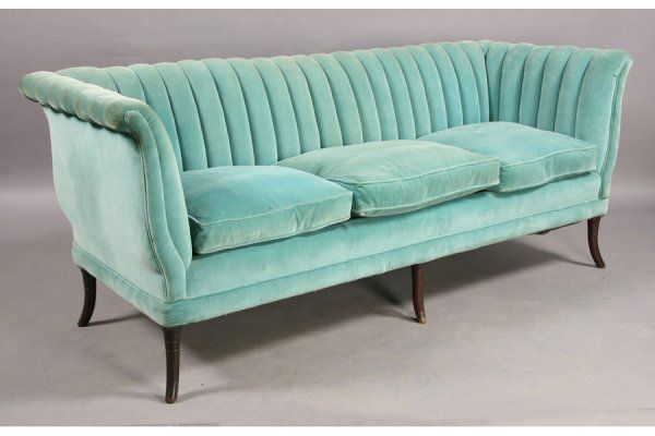 mint channel back sofa..I have a black one similar to this ...I am having it reupholstered a bright tangerine orange <3