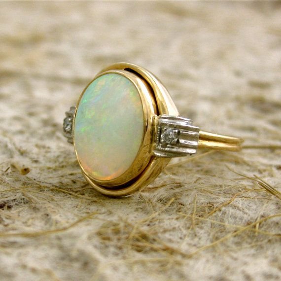 Opals and diamonds. Used to laugh at women who liked shiny things, now look at me!