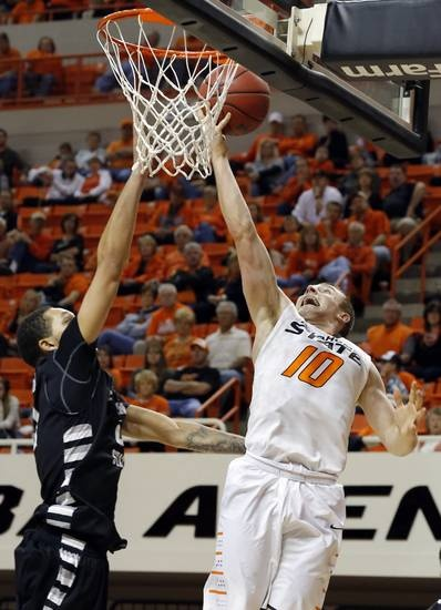 Oklahoma State's Phil Forte (10) shoots over Portland State's Aaron Moore (21) during the college basketball game between Oklahoma State University and Portland State, Sunday,Nov. 25, 2012. Photo by Sarah Phipps, The Oklahoman