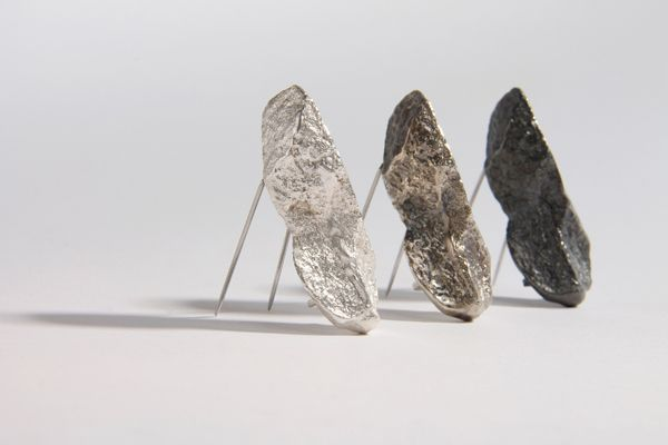 MEGAN FALCONER  - Three rock brooches in silver and oxidised silver: