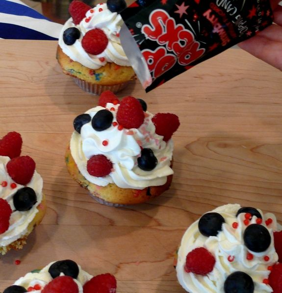 Firecracker Cupcakes with Pop Rocks. This would be a good idea for the 4th of July.