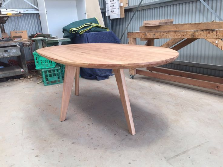 Custom oval dining table made from Blackbutt timber. Tapered angled legs perfect for adding extra chairs for big events. Designed and made by Bombora Custom Furniture Surf Coast. #bomboracustomfurniture #customdiningtable