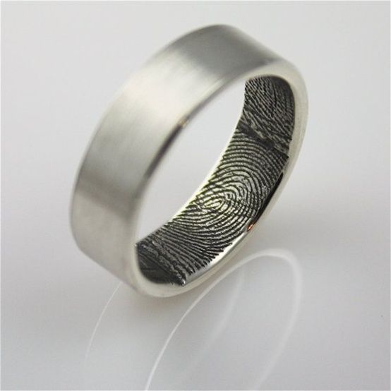 Fingerprint Wedding Rings  -These unique wedding bands feature fingerprints of the spouse inside. His ring has her fingerprint while her ring has his fingerprint. It's a really unique and cute way to carry your love with you always.