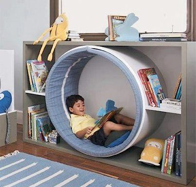 Fun idea that can be dressed up as a space worm hole or a rabbit hole, centre of a flower, any number of ideas to bring a reading nook into playroom.