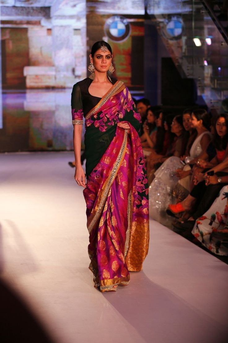 Decode your sangeet look in this Dark green georgette, purple kanjeevaram, patchwork sari with this statement blouse.