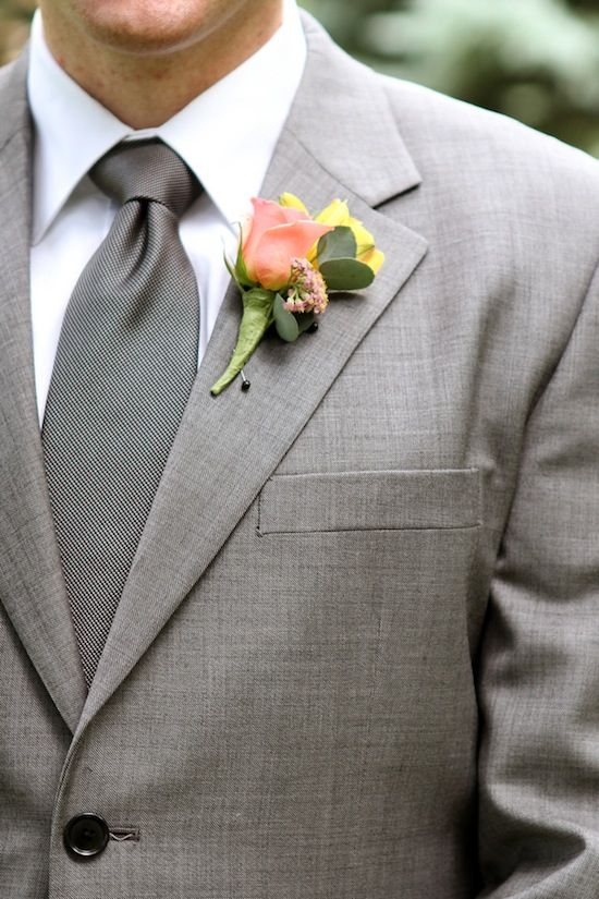 Groomsmen wore grey suits have grey or navy ties and pink carnations or white with baby's breath!