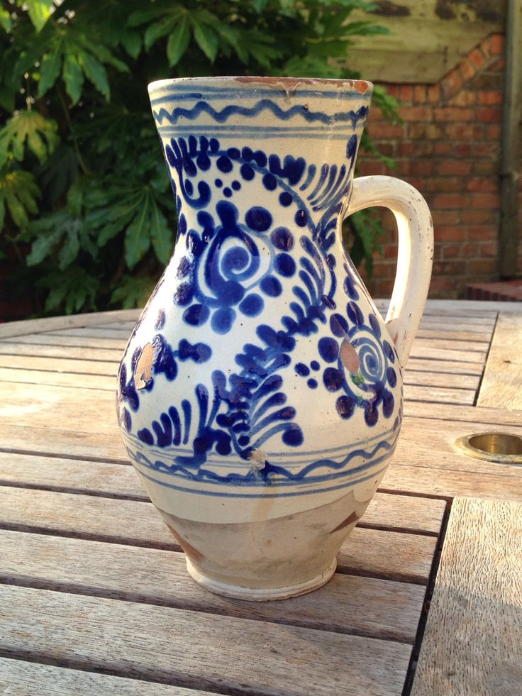 Bokaly drinking jug. Hungary, late 19th or 20th century. White slip on a buff body. Clear lead glaze with decoration in cobalt.