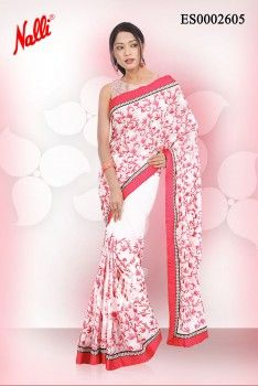 White #Chiffon Saree with #Embroidery work on body and Attached Border. Includes Unstitched Blouse. To shop online click the link below http://www.nallisilks.com/store/sarees/party-wear/embroidery/white-chiffon-saree