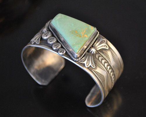 Yes, there is green turquoise.  This stone comes from the High Lonesome turquoise mine in southern New Mexico.