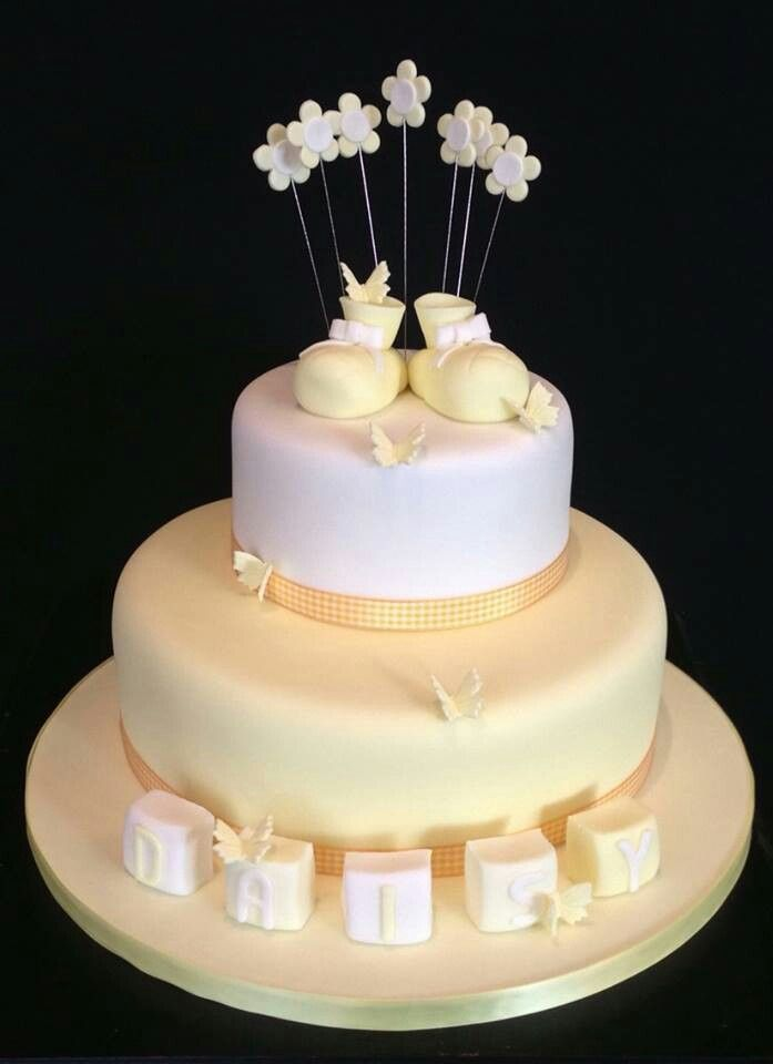 A cute lemon and white christening cake