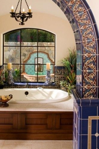 Love the blue tiles and and hte chandelier... mediterranean bathroom by Maraya Droney Design