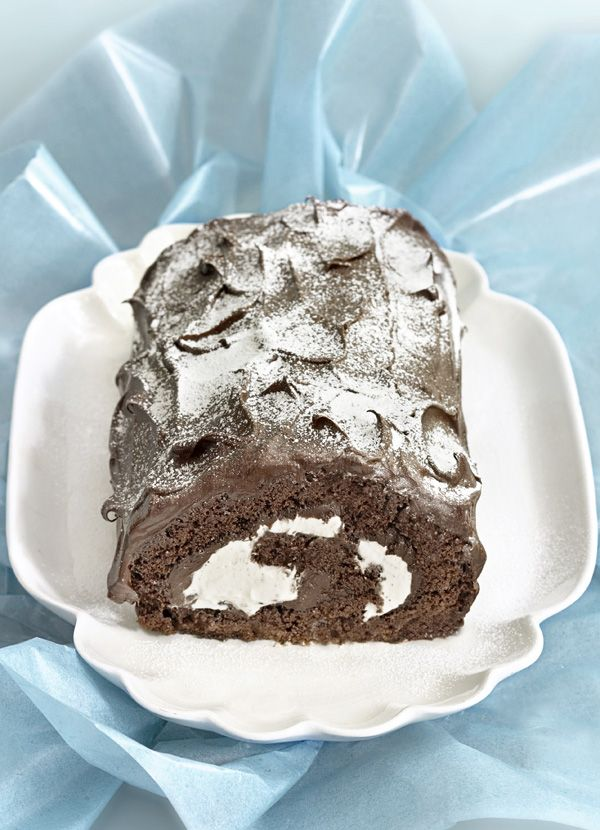 Posh yule log: Our best irresistible yule log recipe. Everyone will attempt to save room for this dark chocolate roulade with Bailey's cream, dusted with a snow drift of icing sugar